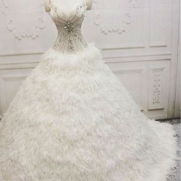 Wedding Dress Sexy Sweetheart Beading Ball Gown Wedding Dresses Chapel Train With Feathers