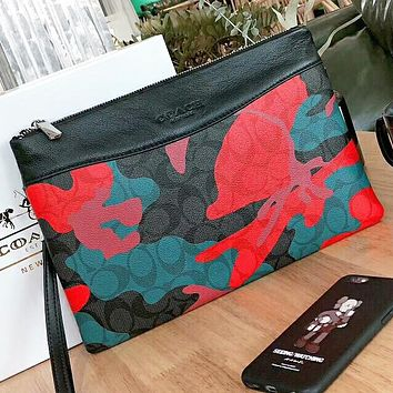 COACH New fashion pattern leather couple cosmetic bag handbag file package