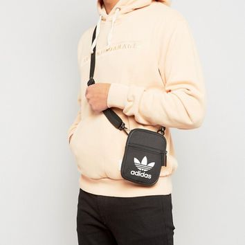adidas Originals Trefoil Flight Bag In Black BK6730 at asos.com