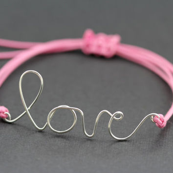 Love Bracelet : Candy Coated. Silver Handwritten Cursive Wire 'LOVE' Bracelet with Pink Cotton Cord, Adjustable, Crimp Beads