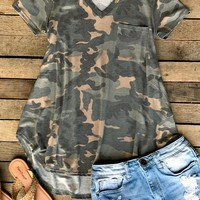 We love us some pocket tee's for Summer! Our Tied Down Pocket Tee is a washed camo pocket tee with short sleeves and v-neckline. Made to be loose fitted and high/low style with curved bottom hem. Super comfortable and trendy!