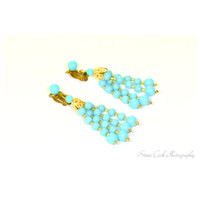 Vintage retro mid century turquoise blue plastic and gold tone clip-on dangle earrings, marked Japan, women's jewelry