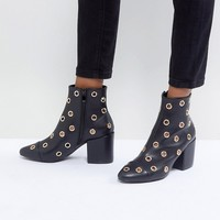 RAID Jadyn Black Eyelet Detail Heeled Ankle Boots at asos.com
