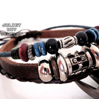 Handmade leather bracelet with very cool silver and wooden beads from Urban Zen Jewelry Boutique