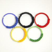 Olympic games 2012 jewelry. Ribbon beaded bracelets - Olympian blue, red, solar power yellow, green, black.