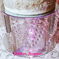 Sale Wedding cake stand. Waterfall and Georgeouis swags of  acrylic crystal wedding cake stand