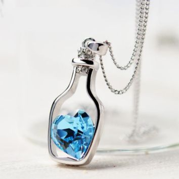 Necklace with Blue crystal heart in a bottle pendant