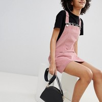 Bershka baby cord overall dress in pink at asos.com