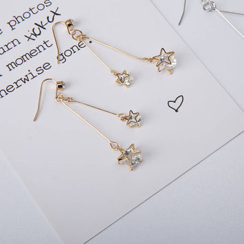 Twink - Gold plated crystal stars dangle earrings