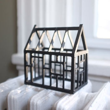 Geometric framework of a miniature house structure in matte black