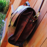 distressed dark whiskey brown unbranded leather satchel. distressed leather messenger. large capacity distressed leather briefcase