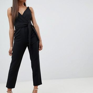 ASOS DESIGN Petite Wrap Front Jumpsuit with Peg Leg and Self Belt at asos.com