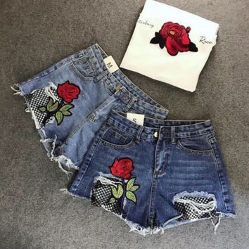 Fashion leisure joker embroidered roses torn net denim shorts