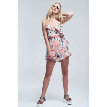 Pink floral romper with ruffles