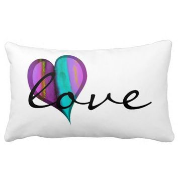 heart pillow with text love on white