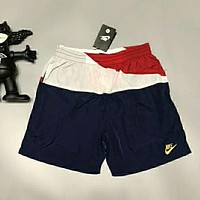 NIKE Fashion new embroidery letter leisure sports red white blue splice women and men shorts