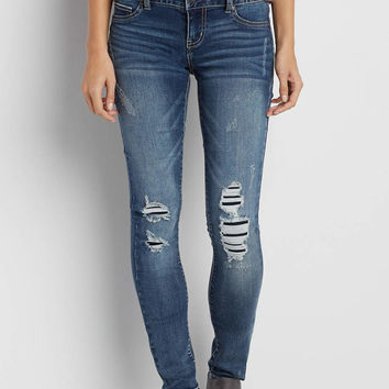 DenimFlex™ jegging in medium wash with lined destruction | maurices