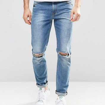 ASOS Skinny Jeans In Mid Wash With Knee Rips at asos.com
