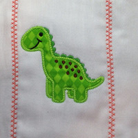 Burp cloth with cute applique green dinosaur. It can be personalized for an extra charge.