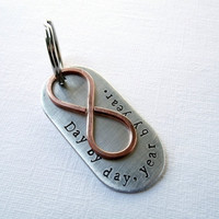 Day by day, year by year. Dog tag style key chain with copper infinity charm.