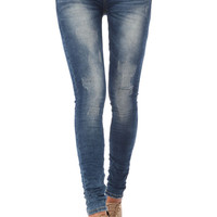 Skinny jeans with distressed finish