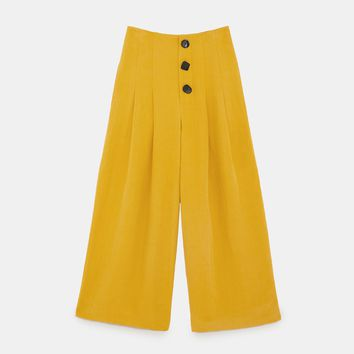 PLEATED TROUSERS WITH BUTTONS DETAILS