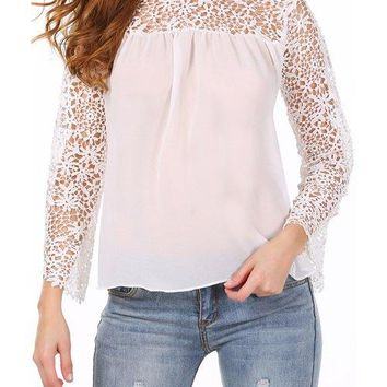 Stylish Long Sleeve Round Neck Hollow Out Solid Color Women's Blouse
