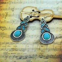 SNAZZY Turquoise Infinity Earrings