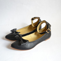 Black faux leather ankle strap flats with bow