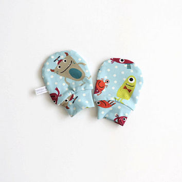 Mint green baby mittens, baby scratch mitts. Jersey cotton knit with polka dots and monsters. Baby Gift Boy or Girl Hand Covers