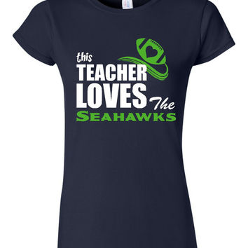 GREAT This Teacher Loves The Seahawks T-shirt! Seattle Seahawks tshirt for teachers! Available in ladies, mens, and various sizes!