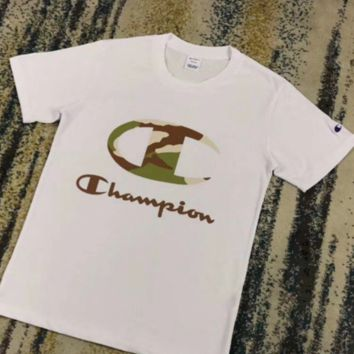 Champion fashion new men and women camouflage print couple short sleeve t-shirt top White