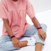 ASOS Oversized Fishnet Sleeves in Berry at asos.com