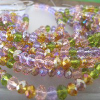 Faceted crystal rondelle beads Perennial flower light color 8 inch strand