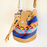 Vintage southwestern leather and woven fabric drawstring crossbody bag