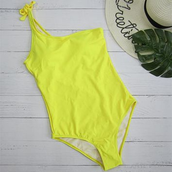 Fashionable and fashionable yellow pure color single-shoulder wear swimsuit sexy bikini