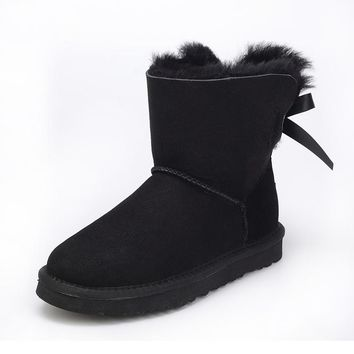 Australia of the natural sheep fur snow boots women short boots / winter warm flat bottomed large boots / free shipping