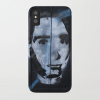 Head on a wall iPhone Case by g-man