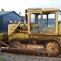 Yellow Caterpillar  Bulldozer on Aldeburgh Beach, Suffolk