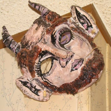 Hand made and hand painted paper mache pan man mask
