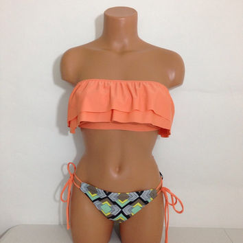 Melon ruffle bandeau with abstract bottoms bikini