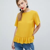 ASOS Woven T-Shirt with Ruffle Hem at asos.com