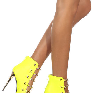 MAKE IT COUNT HEEL - Neon yellow heels featuring a gold capped toe, gold heel, and five gold chains