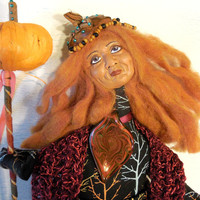 The Pumpkin Queen Handmade Contemporary Folk Art Doll Wall Hanger with Leaf Skirt and Pumpkin Staff by Jeanne Fry