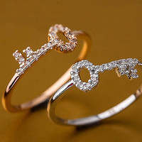 Crystal pave key band ring in silver / pink gold