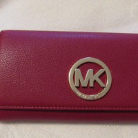 NWT.MICHAEL KORS FULTON CARRYALL CHERRY PEBBLE LEATHER CLUTCH/WALLET..Reg.$148