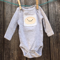 Baby Onesuit with hand sewn Finn from Adventure Time applique