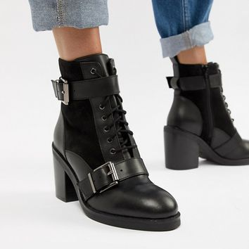 Office All Rise black chunky heeled two buckle boots at asos.com