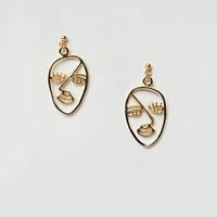 ASOS DESIGN Gold Plated Sterling Silver Abstract Face Earrings at asos.com