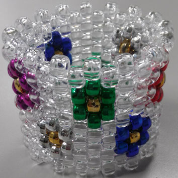 EDC Metallic colored daisies on clear bead kandi cuff